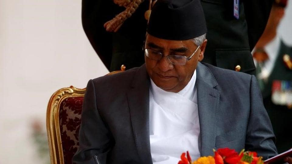 Nepalese Prime Minister Sher Bahadur Deuba signs the oath after swearing-in ceremony at the presidential building in Kathmandu, on June 7, 2017.
