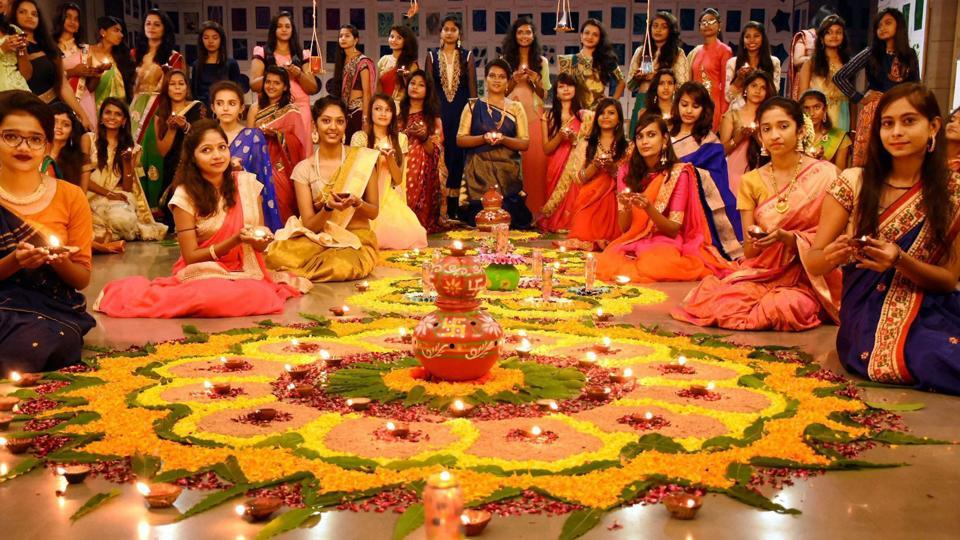 On the eve of 'Dhanteras,' women in Surat are seen in front of an elaborate Rangoli they've made to celebrate 'Vaagh Baras,' which signifies the closing of old accounts and opening of new ledger before the auspicious day of Diwali.  (PTI)
