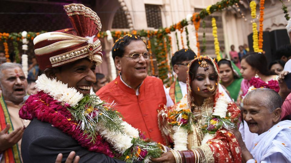 Rakesh Kumar (left) smiles at the solemnization of his marriage to Vinita Devi in Vrindavan. They had a court marriage in 2014 but lacked societal acceptance, hence Sulabh International stepped in to help them with the ceremonial rituals. (Burhaan Kinu / HT Photo)