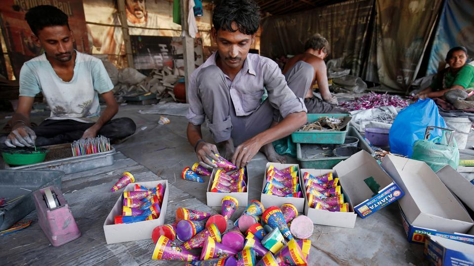As much as they've come under the scanner of the Supreme Court, firecrackers are still very popular as the main attraction on Diwali day. Gujarat sees one of India's largest firecracker sales and workers are seen here making a batch of 'anars' in a factory on the outskirts of Ahmedabad. (Amit Dave / Reuters)