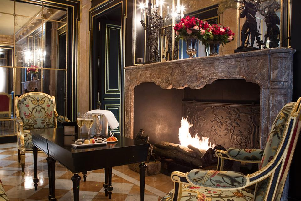 Rooms are decorated lavishly with silk walls, velvet drapes, antique furnishings, and marble fireplaces.