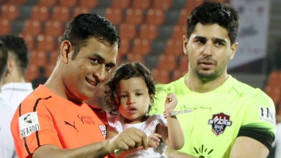 MSDhoni and daughter Ziva during the Celebrity Clasico charity football match in Mumbai on Sunday. Several Bollywood stars like Sidharth Malhotra took part in the match.