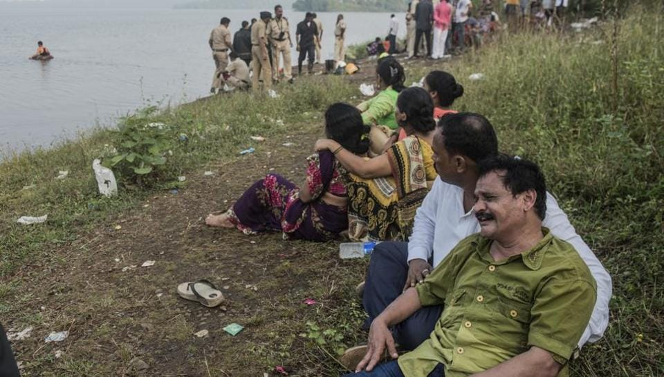 Prathamesh's parents wait in hope at Vihar Lake, while the police and fire brigade personnel conduct search operations.