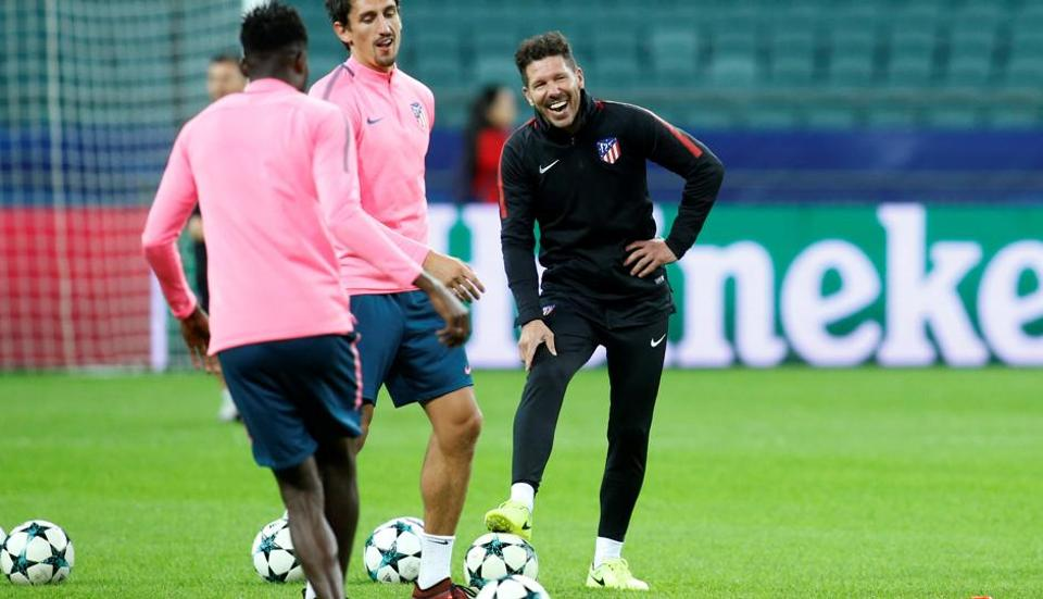 Atletico Madrid coach Diego Simeone shares a light moment with his players during a training session a day before their UEFAChampions League match against Qarabag  at the Olympic Stadium in Baku, Azerbaijan, on Tuesday.