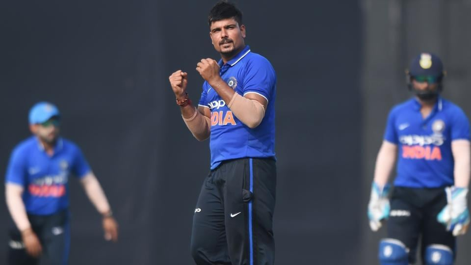 Karn Sharma (C), who played for the Board President's XI, celebrates after taking the wicket of New Zealand cricket team captain Kane Williamson during the warm-up match at the Cricket Club of India (CCI) stadium in Mumbai on Tuesday.