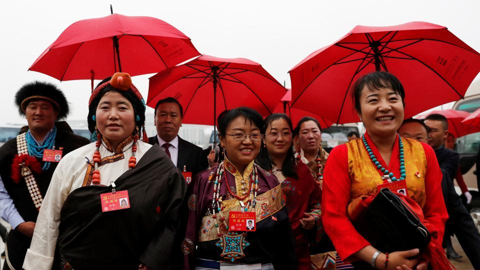 Delegates in traditional costumes arrive for the National Congress at the Great Hall of the People in Beijing. 'Through a long period of hard work, socialism with Chinese characteristics has entered a new era, this is a new historical direction in our country's development,' Xi said in the speech carried live across the nation on state television. (Tyrone Siu / REUTERS)