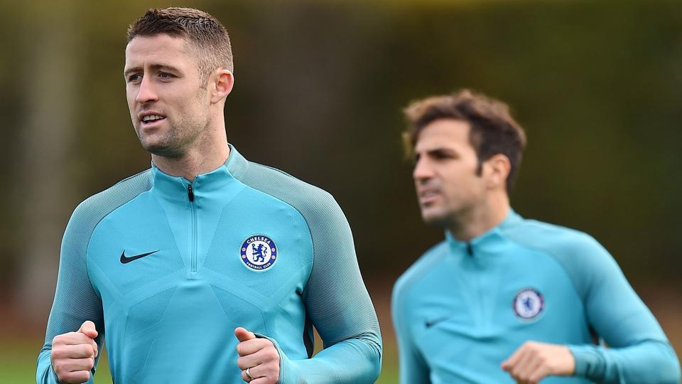 Chelsea FC defender Gary Cahill attends a training session ahead of their UEFA Champions League match against AS Roma .