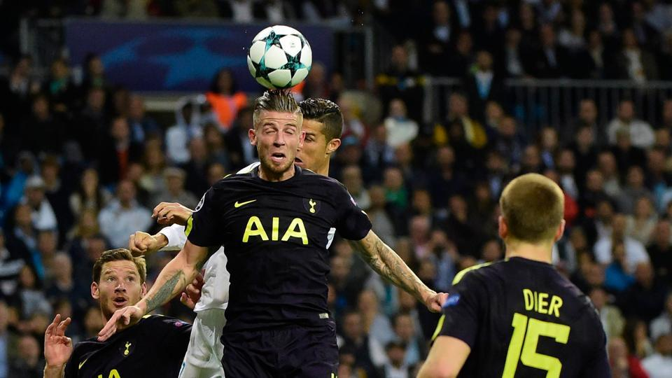 Tottenham Hotspur's Toby Alderweireld (C) vie for the ball with Cristiano Ronaldo of Real Madrid C.F. during their UEFA Champions League group H football match at the Santiago Bernabeu on Tuesday.