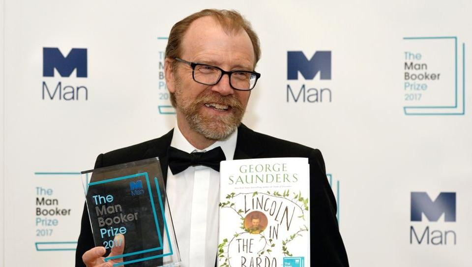 George Saunders, author of 'Lincoln in the Bardo', poses for photographers after winning the Man Booker Prize for Fiction 2017 in London on October 17.
