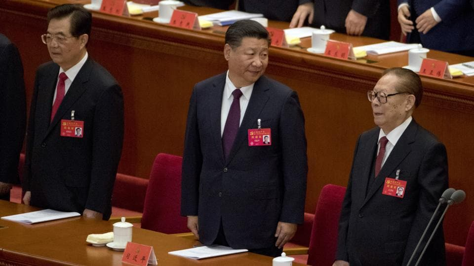 Xi Jinping (C), former President Jiang Zemin (R), and former President Hu Jintao (L) at the opening ceremony of the 19th Party Congress in Beijing. Xi told the congress that the nation's prospects are bright but challenges are severe, pledging that the party would have 'zero tolerance' for corruption and would 'continue to purify, improve and reform itself' — an indication that it would not allow outside checks on graft. (Ng Han Guan / AP)