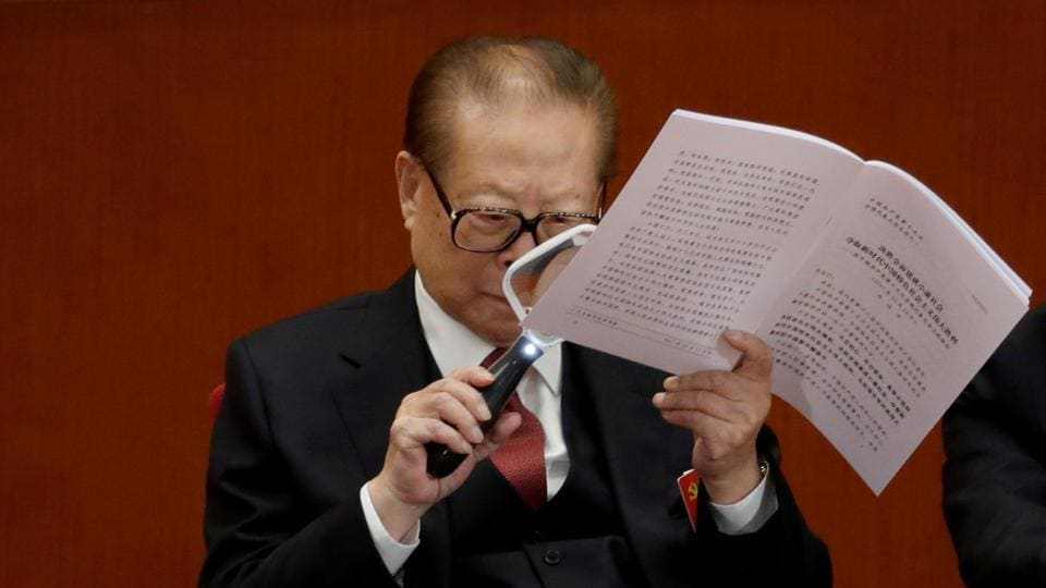 Former Chinese President Jiang Zemin reads through President Xi's report during the congress. Key questions include whether Xi ally and top corruption-buster Wang Qishan will stay on past traditional retirement age. Another measure of Xi's power will be whether he manages to have his own political philosophy added to the constitution, elevating him to the level of leaders like Mao Zedong and Deng Xiaoping. (Jason Lee / REUTERS)