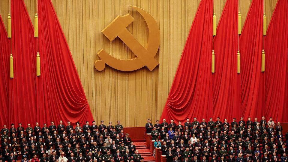 Chinese President Xi Jinping and other high ranking officials clap their hands during the opening session of the 19th National Congress of the Communist Party of China at the Great Hall of the People in Beijing, China October 18.