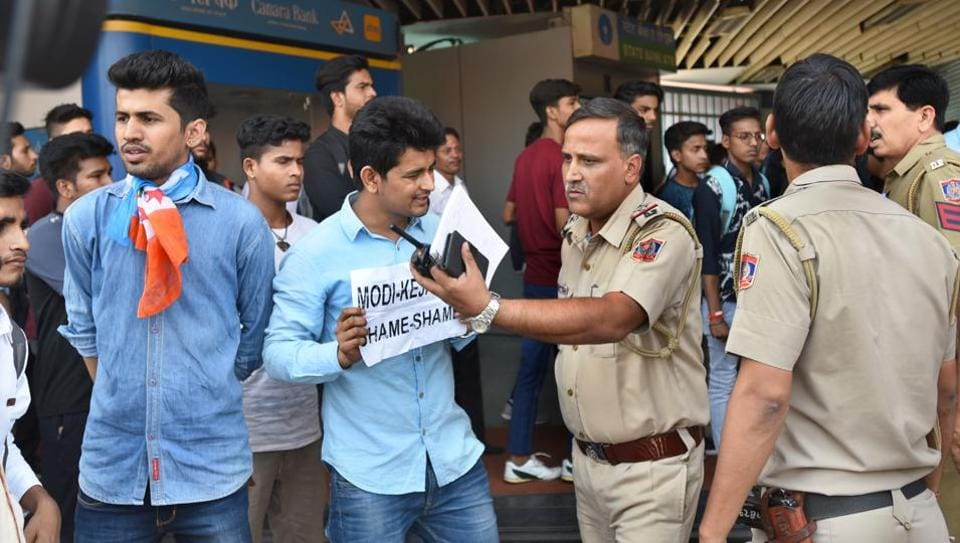 Members of NSUI protest against the hike in the fare of Delhi Metro at Vishwavidhyalaya station in New Delhi.