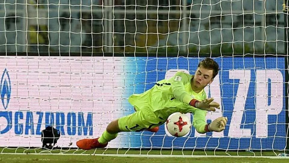 England U-17 national football team goalkeeper Curtis Anderson saves a Japanese player Hinata Kida's penalty shot during the tiebreaker shootout of their FIFA U-17 World Cup pre-quarterfinal match in Kolkata on Tuesday.