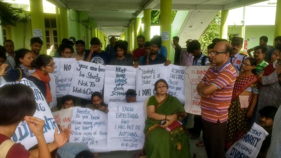 Students at the Satyajit Ray Film and Television Institute during the gherao of its director Debamitra Mitra (in green sari) to protest the expulsion of  14 female students for refusing to move to a new women's hostel.