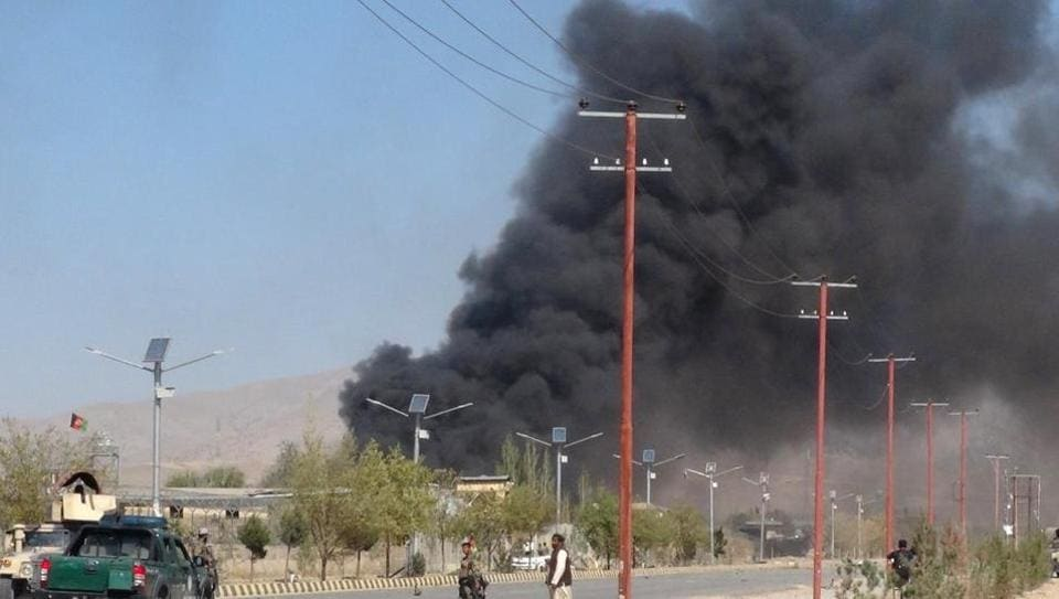Afghan officials say the Taliban have carried out two suicide car bombings at an army camp in the southern Kandahar province