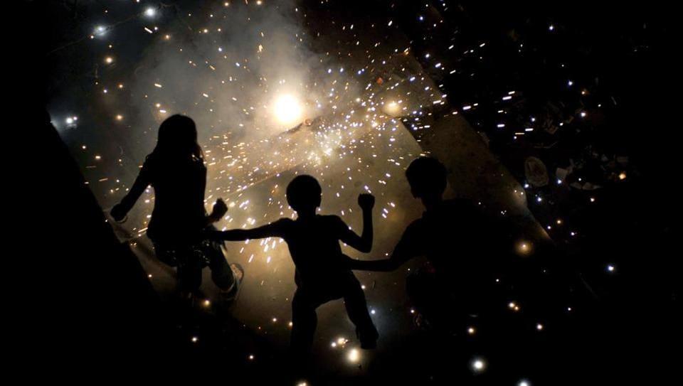 (FILES) This file photo taken on October 27, 2011 shows children lighting fireworks for the Diwali festival in New Delhi.