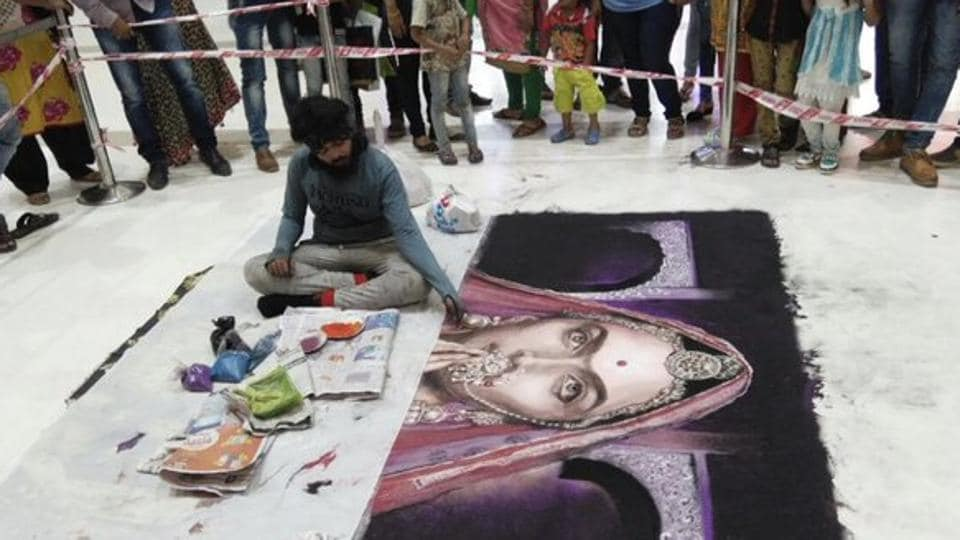 The rangoli was created by an artist at Rahul Raj Mall in Umra area on October 15, 2017.