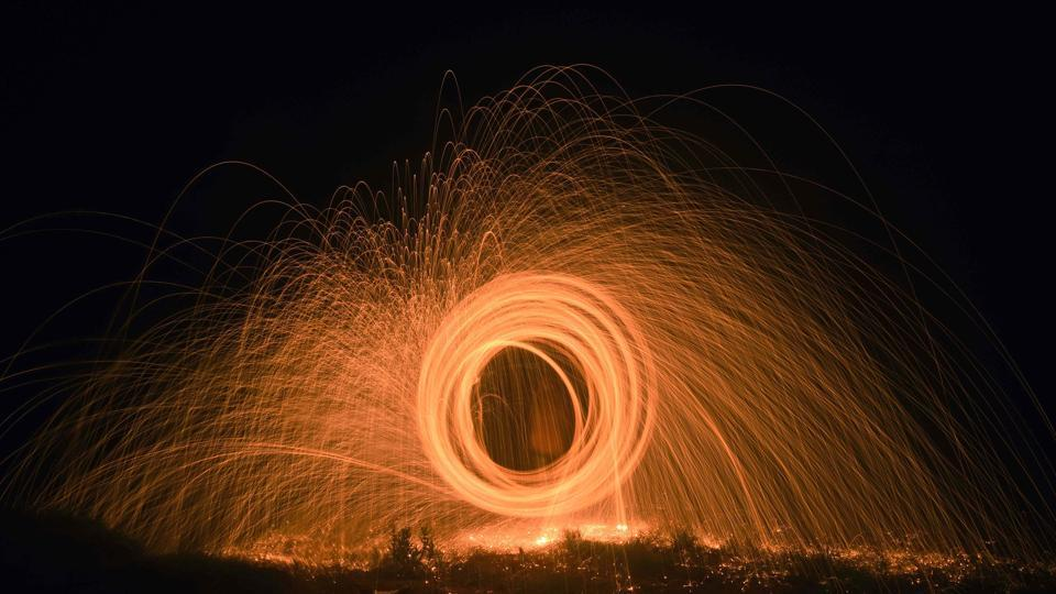 For capturing a steel wool light trail, steel wool is set on fire and is then spun, following which it creates a sort of visual distortion. (Pratham Gokhale/HT Photo)