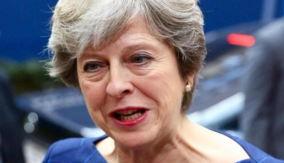 Britain's Prime minister Theresa May speaks to journalists as she arrives in Brussels, on October 19, 2017 on the first day of a summit of European Union (EU) leaders, set to rule out moving to full Brexit trade talks after negotiations stalled.