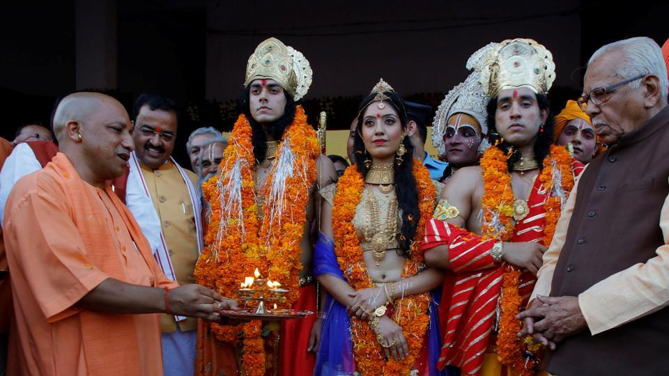 UP chief minister Yogi Adityanath (left) with artists dressed as Rama, his wife Sita and his brother Laxman during Diwali celebrations in Ayodhya, on October 18, 2017.