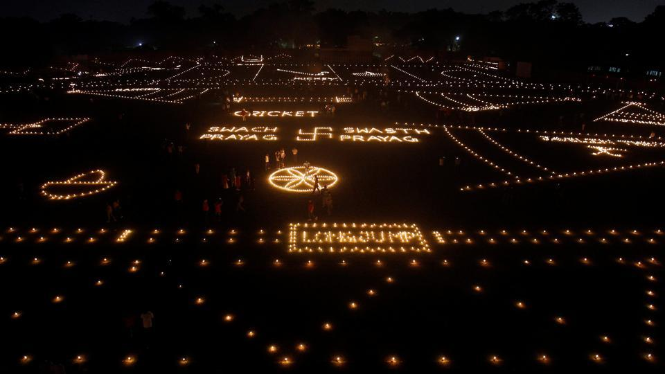 People light candles in a stadium as part of Diwali, the Hindu festival of lights, celebrations in Allahabad. (Jitendra Prakash / REUTERS)