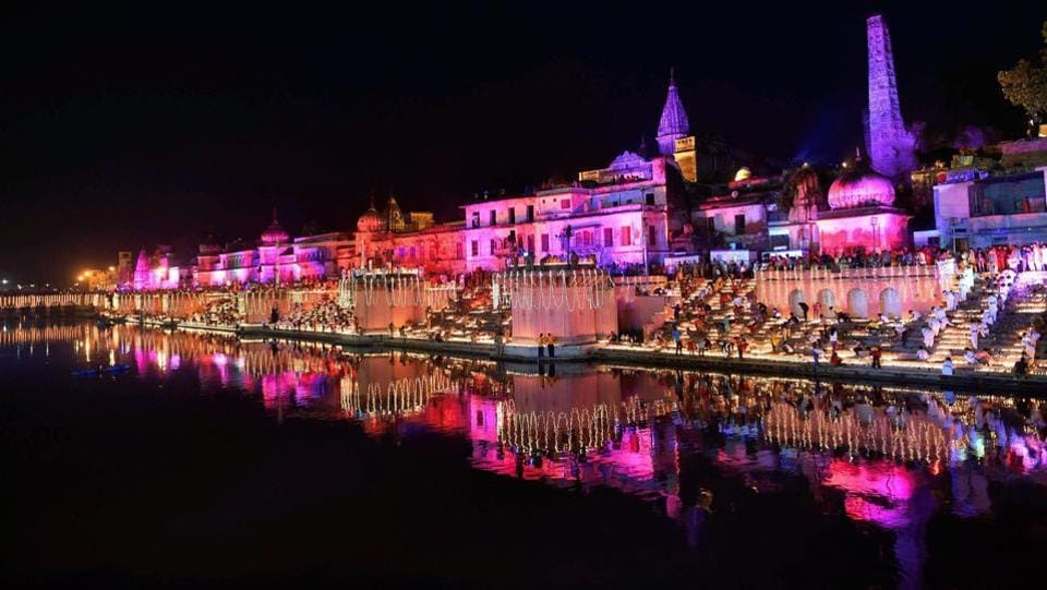 People light earthen lamps on the banks of River Saryu during Deepotsav in Ayodhya, Uttar Pradesh on Wednesday. The UP state tourism department in association with the Avadh University and the district administration aimed to set a new world record by lighting more than 171,000 earthen oil lamps on the stairs of the Sarayu ghats at Ram Ki Paidi . (Nanad Kumar / PTI)