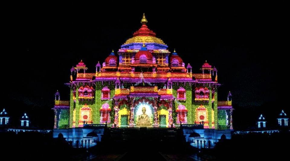 The Swaminarayan Akshardham temple is illuminated with laser lights projections as a part of Diwali celebrations in Gandhinagar, Gujarat. (PTI)