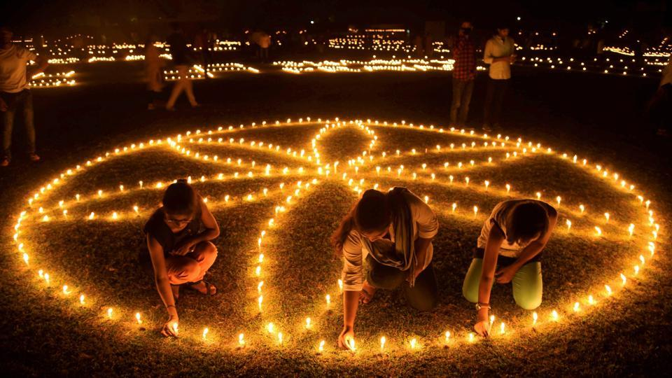Young Hockey players light candles in an elaborate formation at Madan Mohan Malviya Stadium during Diwali festival celebration in Allahabad, Uttar Pradesh. (PTI)
