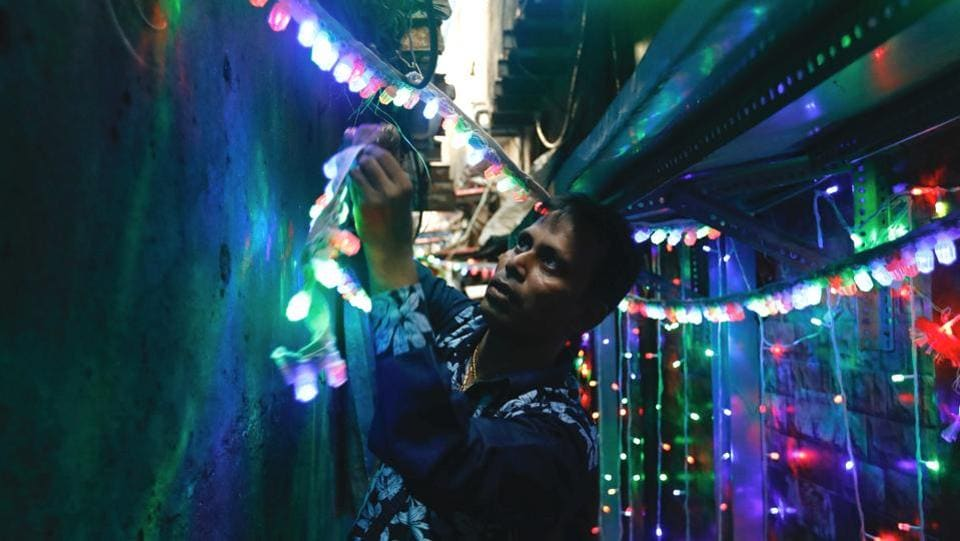 A man hangs lights in an alley on the eve of Diwali in a slum in Mumbai, Maharashtra. A time to celebrate and connect with friends and family, Diwali n modern India has almost become synonymous with bursting firecrackers. The Supreme Court's recent ban on firecrackers in Delhi NCR this year while met with mixed responses, has also resulted in awareness for the importance of safer, greener alternatives. (Danish Siddiqui / REUTERS)