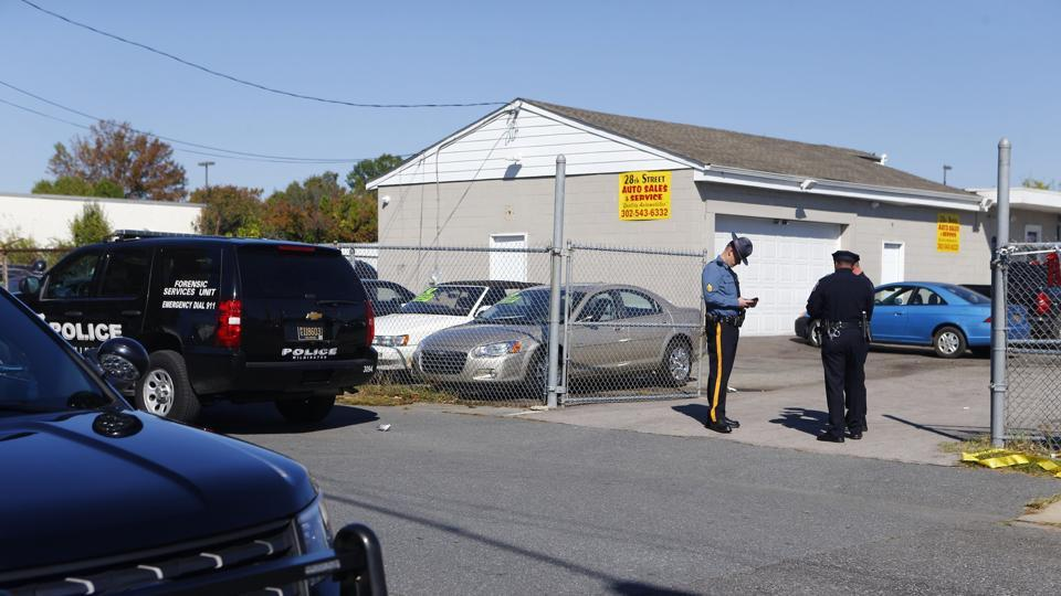 Police investigate the scene of a shooting in Delaware on October 18, 2017. Radee Labeeb Prince, wanted in the shooting of several people at his workplace in Maryland is now suspected in a later shooting in Delaware.
