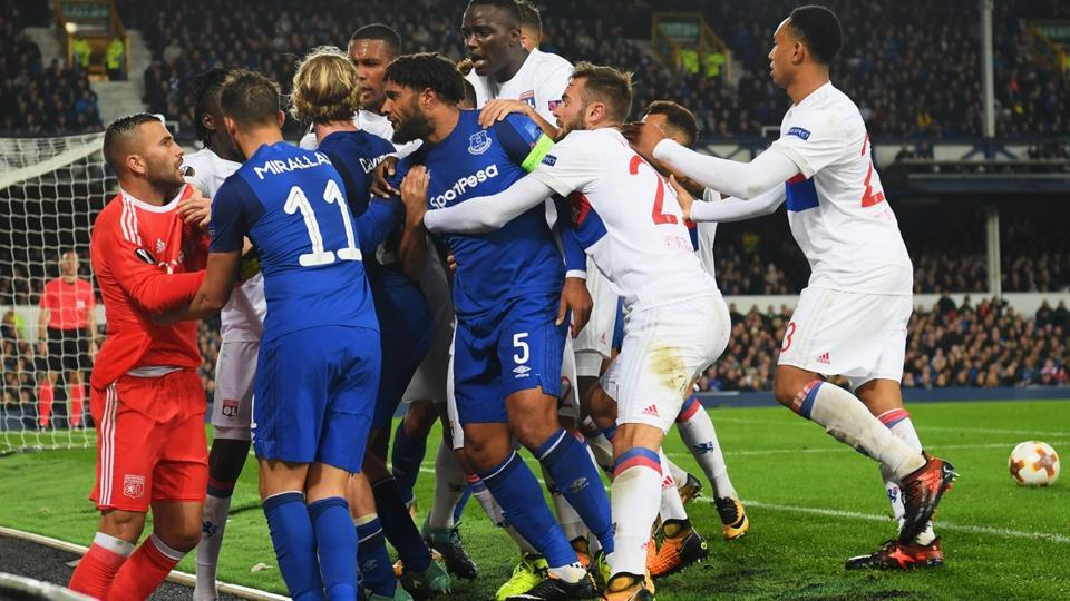 Ashley Williams was at the centre of an ugly brawl between Everton and Lyon players during a UEFA Europa League game, which even saw an Everton fan punch Anthony Lopes with one hand while holding a child in the other.