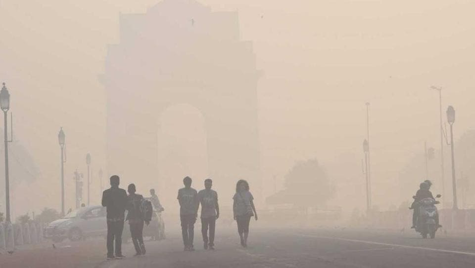 People walk near the India Gate a day after Diwali, in New Delhi.