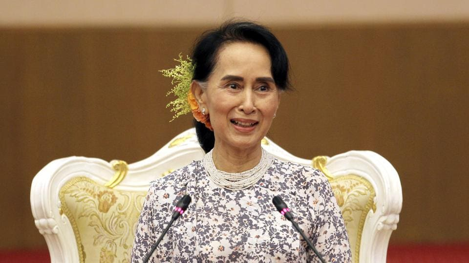 Myanmar's state counsellor Aung San Suu Kyi smiles during a ceremony to accept cash provided by private donors for development tasks in Rakhine state at the National Reconciliation and Peace Centre in Naypyitaw on October 20, 2017.