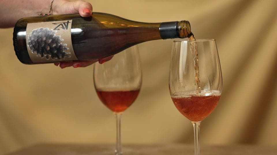 The unique amber-colored wine is creating a buzz in an industry long dominated by shades of red, white and rose. The orange color comes not from citrus fruit, but by fermenting white wine grapes with their skins on before pressing, a practice that mirrors the way red wines are made.