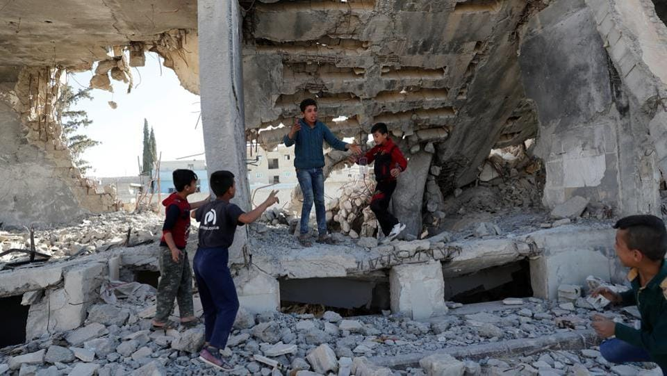 Children play at the ruins of a building destroyed in an air strike during anti ISIS offensives in Kobani, Syria on October 11, 2017. This city may offer a glimpse into what lies ahead for areas where ISIS only recently was driven out. Kurdish fighters fought fiercely here, early in 2015. Nearly three years later, roads are still being repaved, reconstruction has been slow and only a fraction of the prewar population has returned. (Erik De Castro / REUTERS)