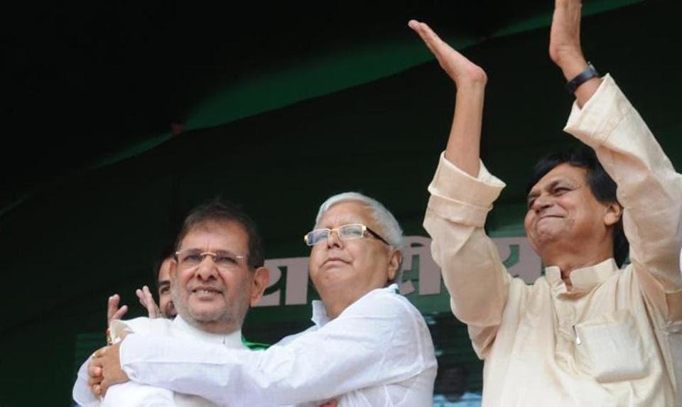 Sharad Yadav (left) and Ali Anwar Ansari (right) with RJDchief Lalu Prasad.