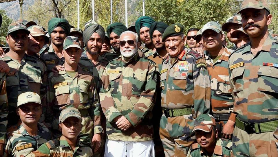 Prime Minister Narendra Modi with the jawans of the Indian Army and BSF, in the Gurez Valley, near the Line of Control, in Jammu and Kashmir, on Thursday.