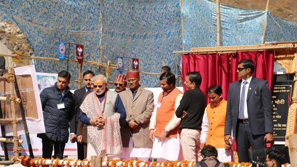 Prime Minister Narendra Modi during the inauguration of reconstruction projects at Kedarnath shrine on Friday. To the PM's right is industrialist Sajjan Jindal (in black jacket) .