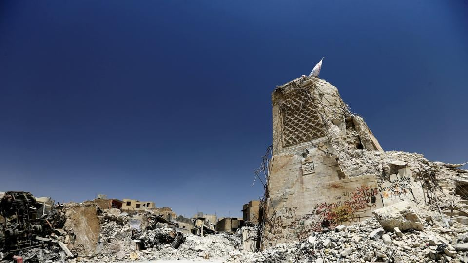 The destroyed al-Hadba minaret at the Grand al-Nuri Mosque is seen in the Old City of Mosul, Iraq on July 20, 2017. Nine months of fighting in the west of Mosul, where militants holed up during their final stand left the area virtually uninhabitable. Before ISIS captured the city, Mosul was home to 1.1 million people. UN officials estimate that just restoring basic services there could cost more than $1 billion. (Thaier Al-Sudani / REUTERS)