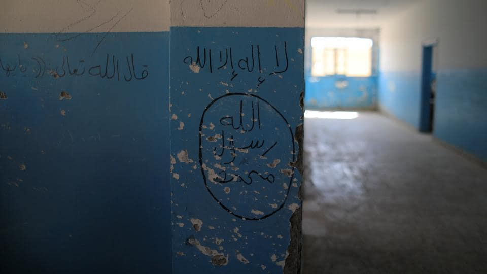An emblem of the Islamic State along with damage from gunfire is seen inside a school during an earlier leg of the battle for Raqqa in Hazema, Syria on August 21, 2017. (Zohra Bensemra / REUTERS)