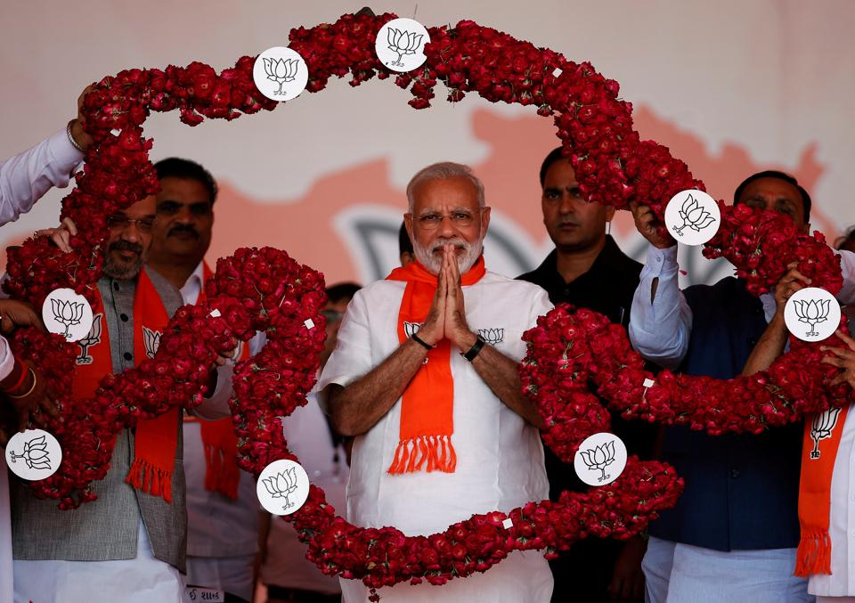 Prime Minister Narendra Modi is garlanded by supporters at a public rally in Ahmedabad on October 16. Modi's home state Gujarat is due for assembly elections in December.