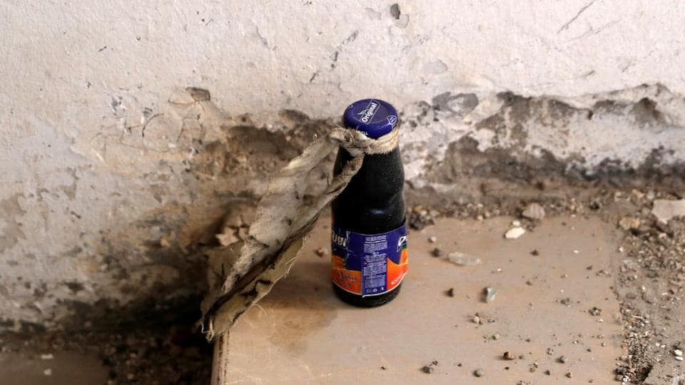An unexploded bomb inside a juice bottle is pictured near the bunker of the Islamic State militants under the stadium in Raqqa, Syria on October 18, 2017. (Erik De Castro / REUTERS)