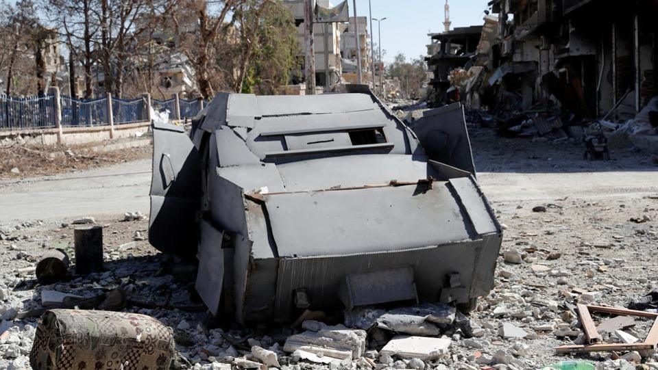 An armoured Islamic State vehicle intended for suicide car bombing is seen along a road in Raqqa, Syria on October 18, 2017. US-backed SDF forces are now combing the ruins of the Syrian city for survivors, bombs and booby traps. (Erik De Castro / REUTERS)