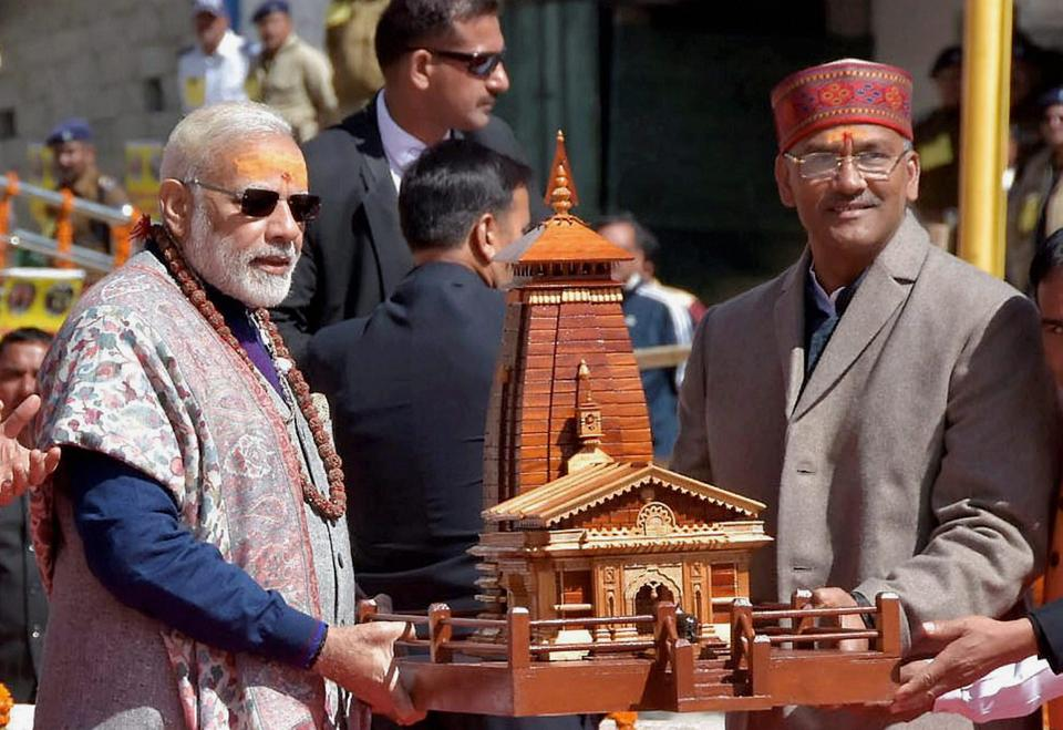 Prime Minister Narendra Modi is felicitated by Uttrakhand Chief Minister Trivendra Singh Rawat during his visit to Kedarnath in Uttarakhand on Friday.