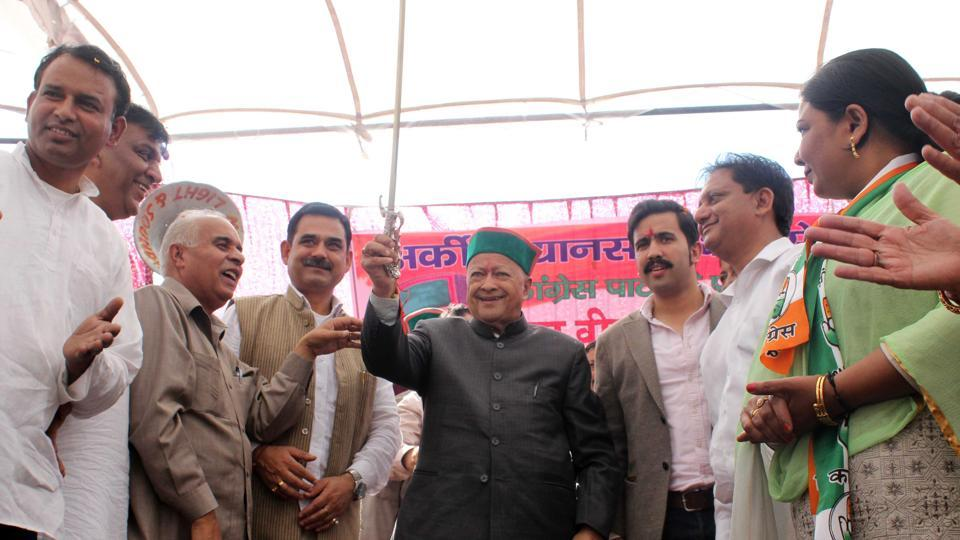 Himachal Pradesh chief minister Virbhadra Singh displaying a sword presented by Congress workers at a public meeting after filing his nominations for the November 9 Vidhan Sabha elections, in Arki constituency in Solan district on Friday.