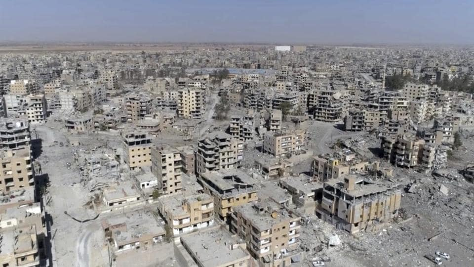 A drone grab reveals mile after mile of damaged buildings, rubble-filled streets and destroyed landmarks in Raqqa, Syria two days after Syrian Democratic Forces said military operations to oust the Islamic State have ended. A long road lies ahead before citizens can return to cities they once called home and remnants of ISIS rule are widespread amid the carnage in the meanwhile. (Gabriel Chaim / AP)