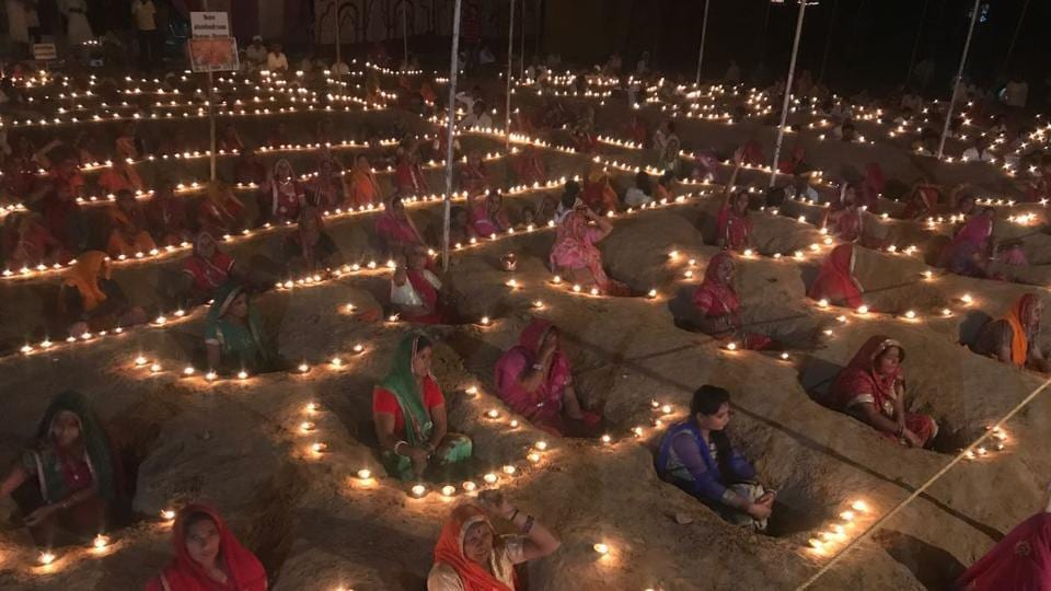 Farmers protest by sitting in pits as they celebrate Diwali at Ninder near Jaipur on Thursday.