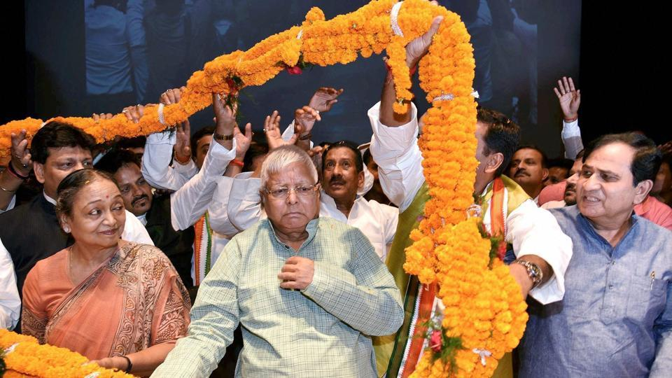 RJD chief Lalu Prasad with Congress leader Meira Kumar being garland by party workers during the 130th birth anniversary of Bihar Kesari Shri Krishna Singh in Patna on Saturday.