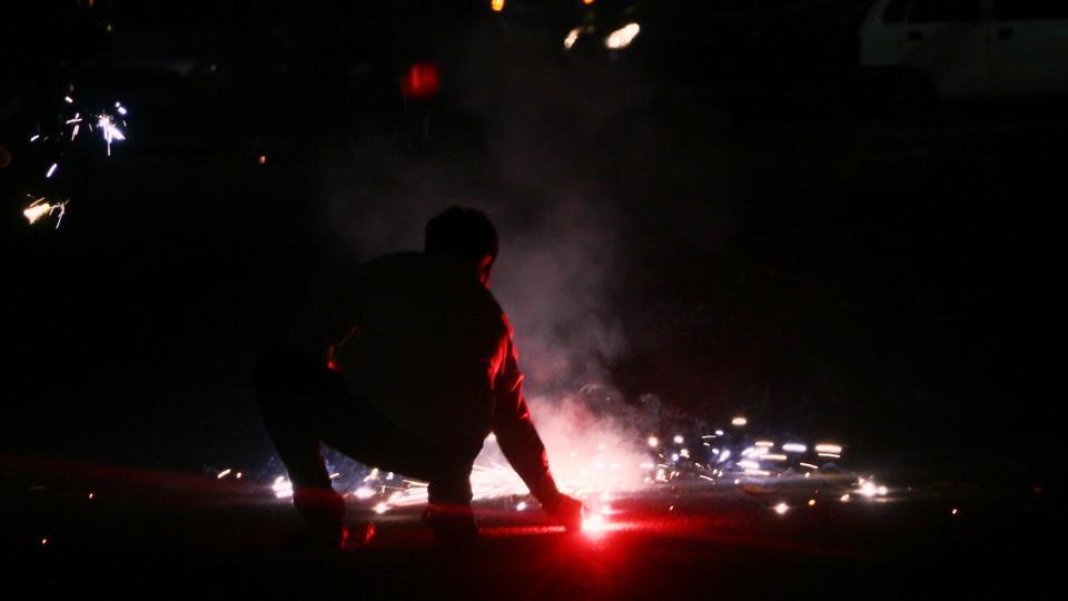 Lighting a cracker on Diwali night
